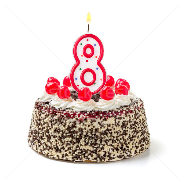 Birthday cake with burning candle number 8 Stock photo © Zerbor