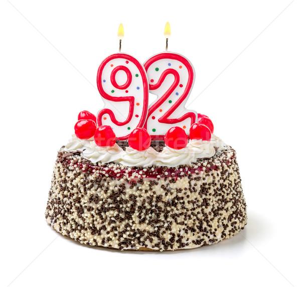 Birthday cake with burning candle number 92 Stock photo © Zerbor
