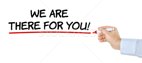 Hand with pen writing We are there for you Stock photo © Zerbor