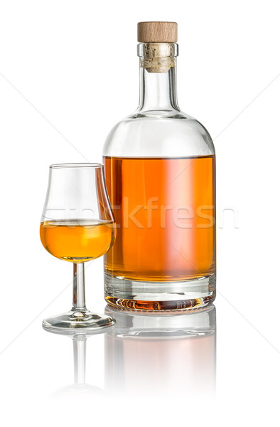 Bottle and snifter filled with amber liquid Stock photo © Zerbor