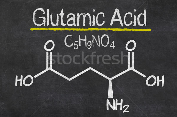 Blackboard with the chemical formula of Glutamic acid Stock photo © Zerbor