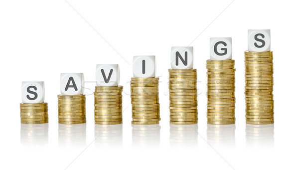Coin stacks with letter dice - Savings Stock photo © Zerbor
