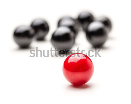 Concept with red and black marbles - Teamleader Stock photo © Zerbor