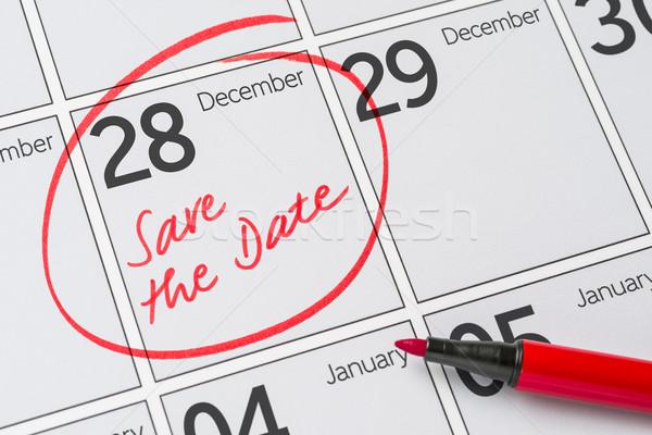 Save the Date written on a calendar - December 28 Stock photo © Zerbor