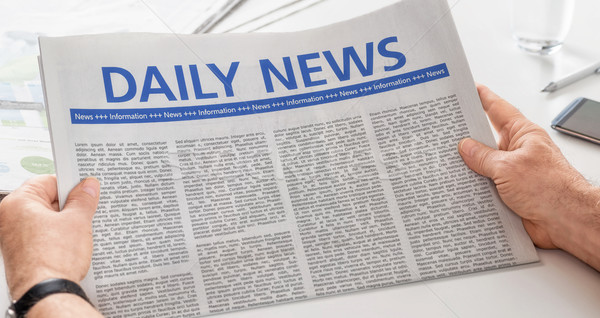 Man reading newspaper with the headline Daily News Stock photo © Zerbor