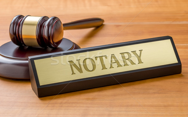 A gavel and a name plate with the engraving Notary Stock photo © Zerbor