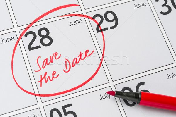 Save the Date written on a calendar - June 28 Stock photo © Zerbor