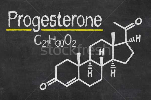 Blackboard with the chemical formula of Progesterone Stock photo © Zerbor