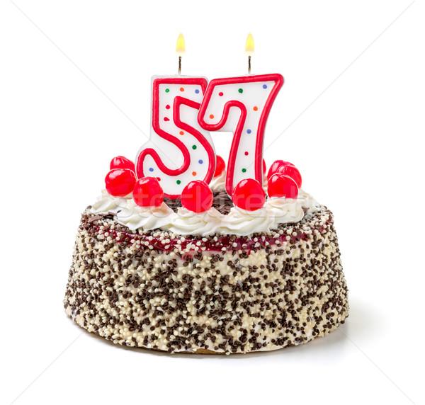 Birthday cake with burning candle number 57 Stock photo © Zerbor