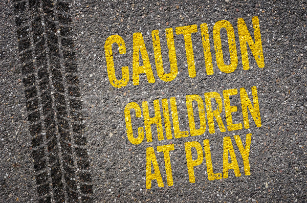 Stock photo: Lane with the text Caution Children at play