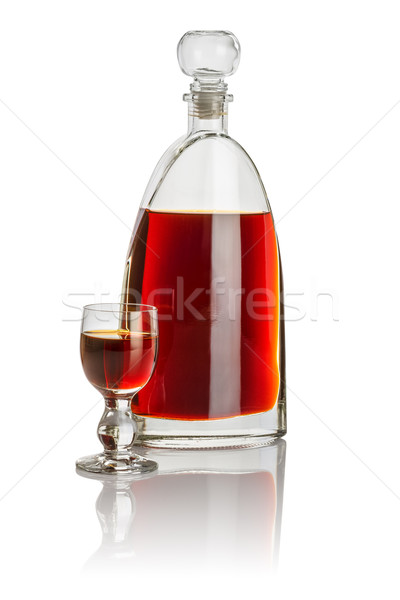 Carafe and glass goblet filled with brown liquid Stock photo © Zerbor