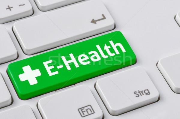 A keyboard with a green button - E-Health Stock photo © Zerbor