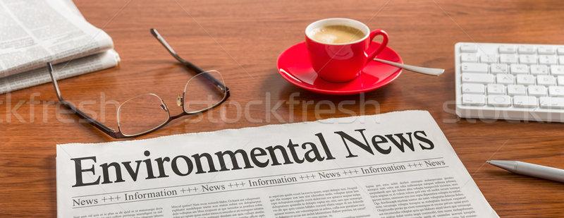 A newspaper on a wooden desk - Environmental News Stock photo © Zerbor