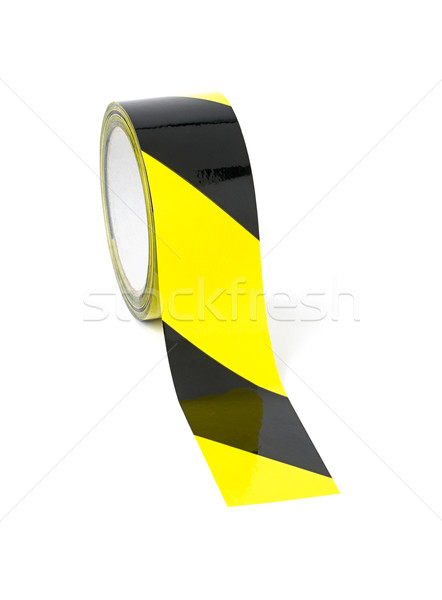 Roll of yellow and black caution tape Stock photo © Zerbor