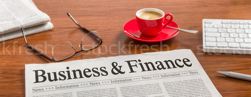 A newspaper on a wooden desk - Business and Finance Stock photo © Zerbor