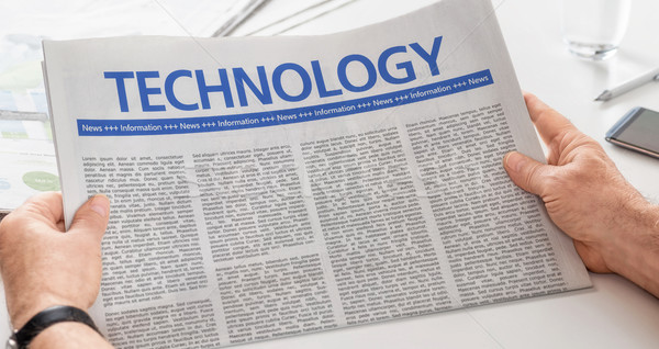 Man reading newspaper with the headline Technology Stock photo © Zerbor