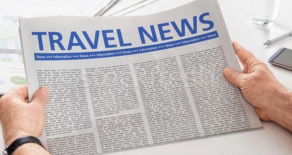 Man reading newspaper with the headline Travel News Stock photo © Zerbor
