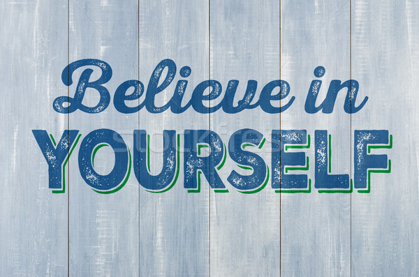 Blue wooden wall with the inscription Believe in yourself Stock photo © Zerbor