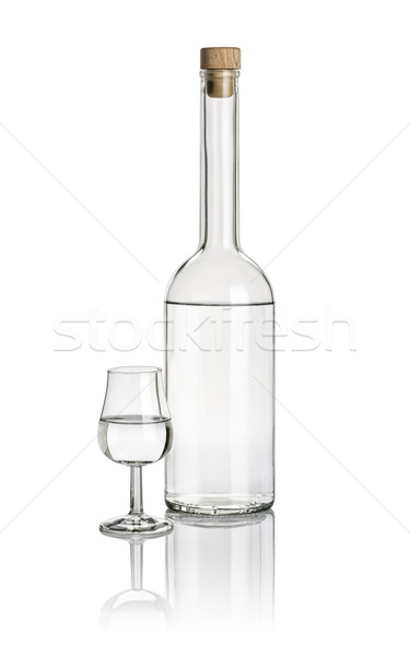 Liquor bottle and snifter filled with clear liquid Stock photo © Zerbor