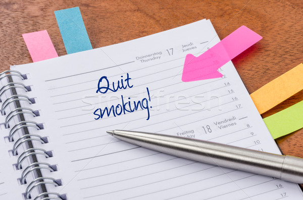 Daily planner with the entry Quit smoking Stock photo © Zerbor