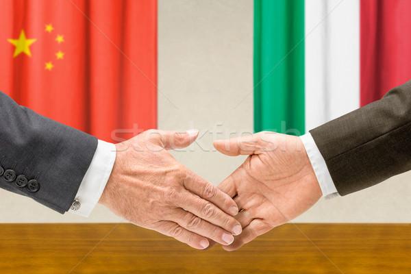 Representatives of China and Italy shake hands Stock photo © Zerbor