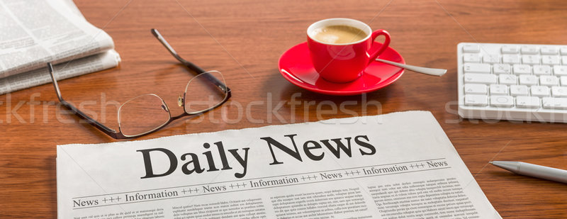 A newspaper on a wooden desk - Daily News Stock photo © Zerbor