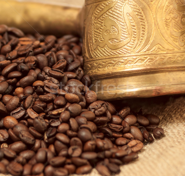 Arabic copper turks and  scattered coffee grains Stock photo © Zhukow