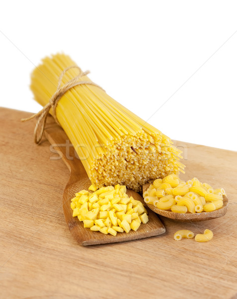 pasta on a wooden board on a white background Stock photo © Zhukow