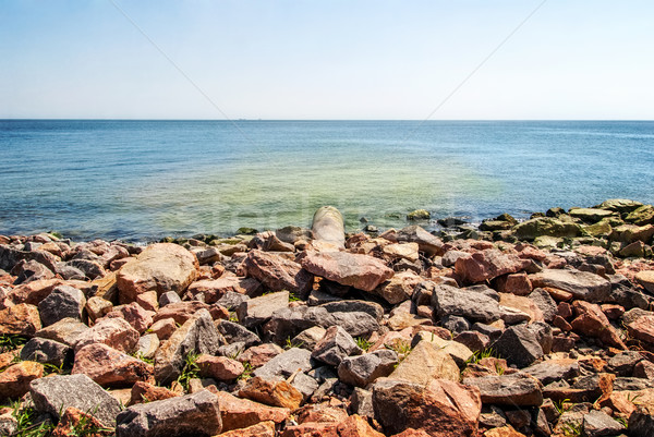overflow pipe coming from the land to the sea Stock photo © Zhukow