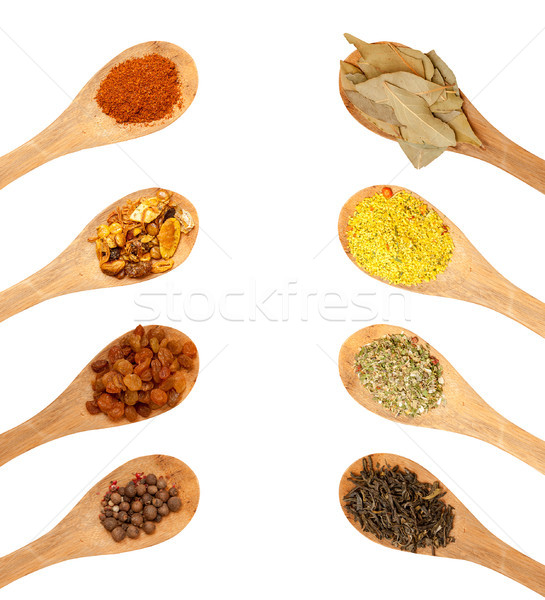 wooden spoons with seasonings on a white background Stock photo © Zhukow