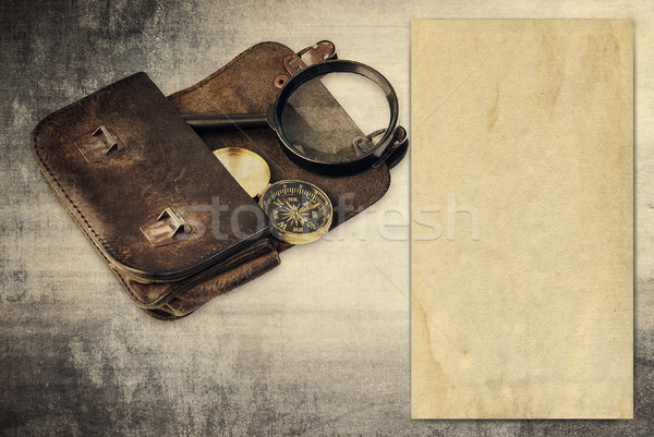 Vintage background with old paper, wallet and compass Stock photo © Zhukow