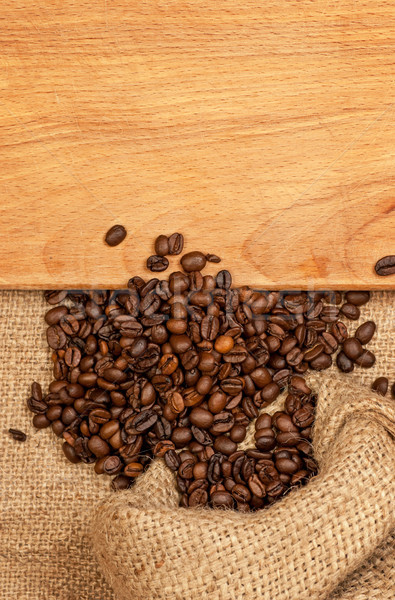 scattered grains of coffee and wooden board Stock photo © Zhukow