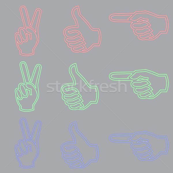 Enseigne au néon forme main trois couleurs Photo stock © Zhukow