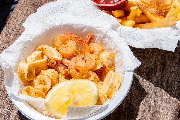 Crispy fresh squid and shrimp in white plate. Stock photo © Zhukow