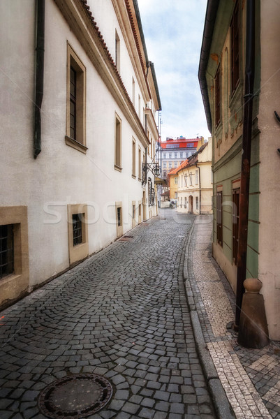 Morning in old city without people . Prague. textured old paper background Stock photo © Zhukow