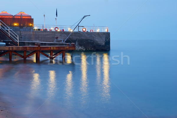 Navy Pier at night in coming beams of the sun Stock photo © Zhukow