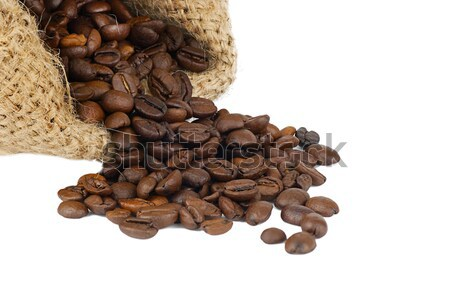 scattered coffee grains on a white background Stock photo © Zhukow