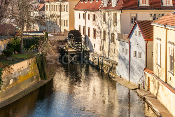 Old watermill on Chertovka river in Prague. Stock photo © Zhukow