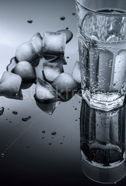 glass of water and ice cubes on a dark background Stock photo © Zhukow