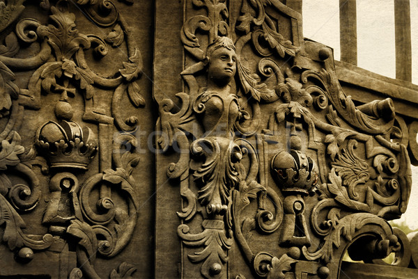 Vintage forged decorative element on metal gate. Stock photo © Zhukow