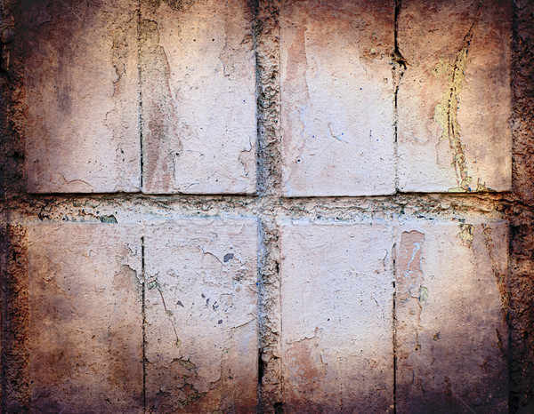 Grunge texture of pastel colour broken tiles on old wall Stock photo © Zhukow