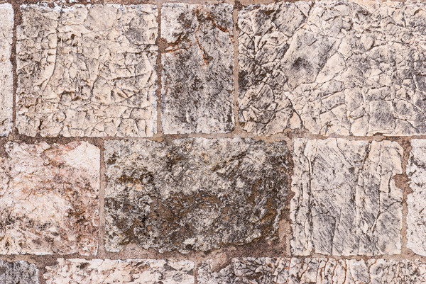 Old wall made of the Jerusalem stone Stock photo © Zhukow