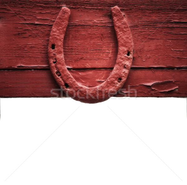 The old horseshoe hanging on wooden wall Stock photo © Zhukow