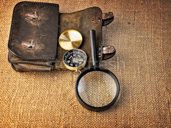 Vintage background with  wallet, compass and magnifier Stock photo © Zhukow