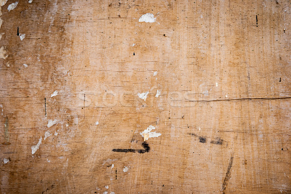 wood texture with cracks and the remnants of the old paper Stock photo © Zhukow