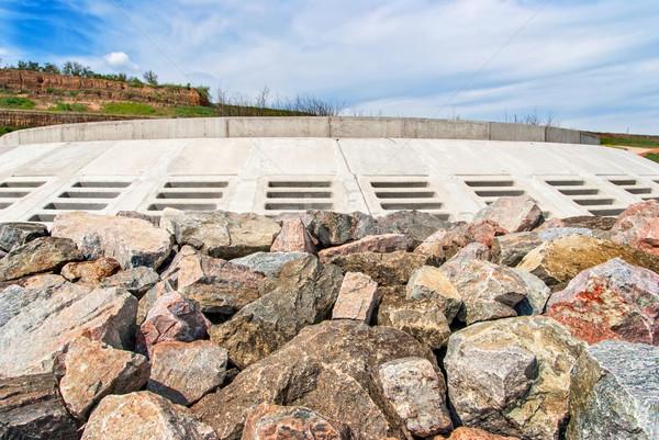 Massive stone breakwater along coast Stock photo © Zhukow