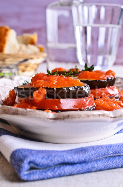 Baked eggplant with tomato and cheese Stock photo © zia_shusha