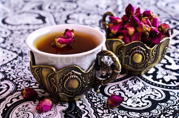 Tea roses in a beautiful Cup with Oriental motifs Stock photo © zia_shusha