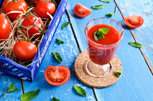 Succo di pomodoro vetro menta foglie finestra pomodori Foto d'archivio © zia_shusha