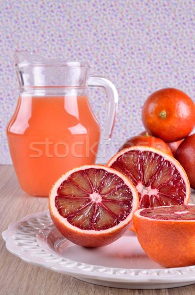 Vermelho laranja cortar comida prato suco Foto stock © zia_shusha